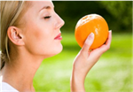Photo of woman eating an orange