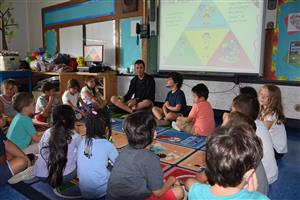 Southampton Elementary School students participate in mindful activities daily. Coach Rob Neff spoke to first-graders about m